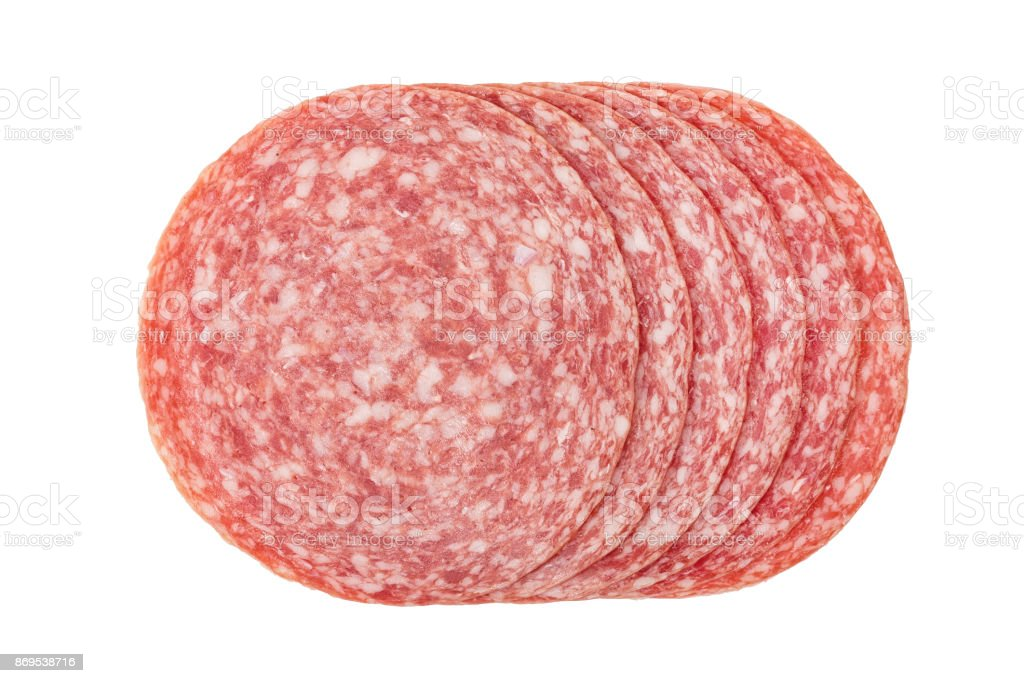 Sliced summer sausage salami isolated on white background, top view. stock photo