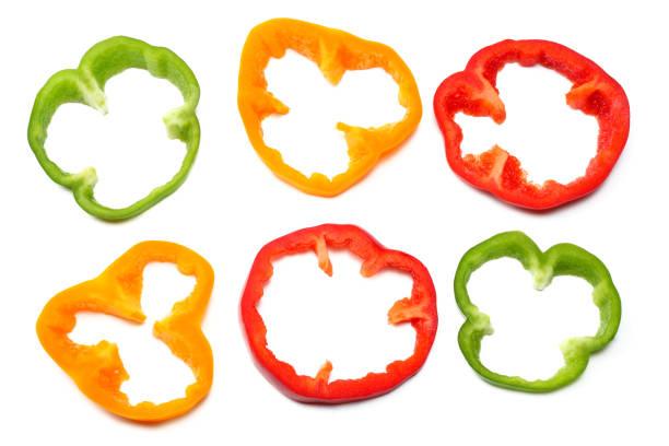 sliced sweet bell pepper isolated on white background. top view - papryka słodka zdjęcia i obrazy z banku zdjęć