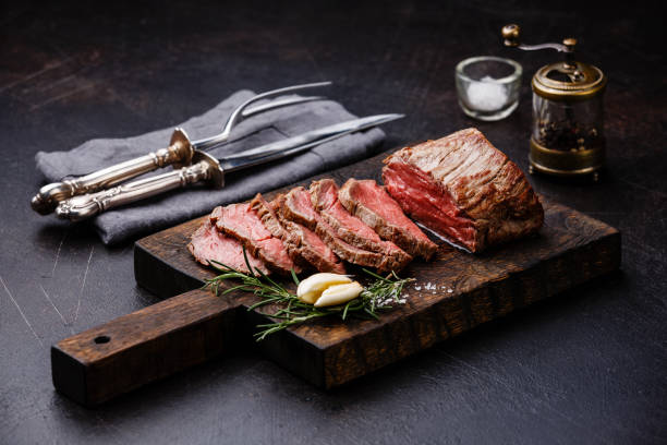 sliced tenderloin meat roast beef and carving set - beef stock pictures, royalty-free photos & images