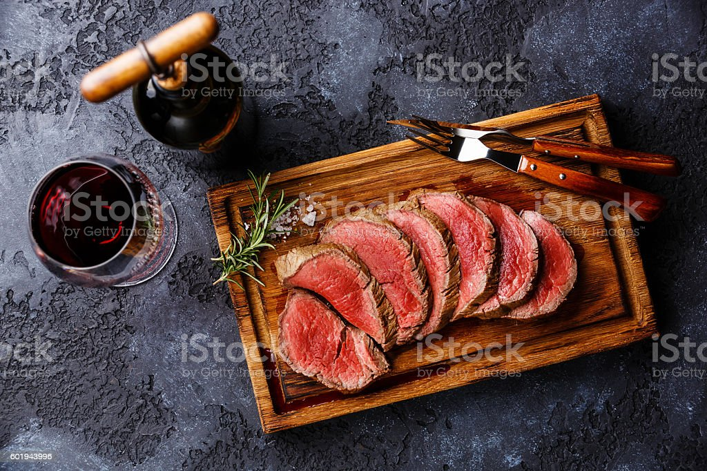 Sliced tenderloin Steak roastbeef and Red wine stock photo