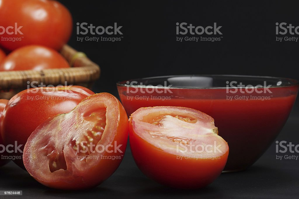 Sliced tomato in darkness royalty-free stock photo