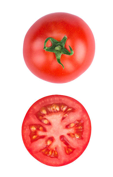 sliced tomatoe isolated on white background top view stock photo