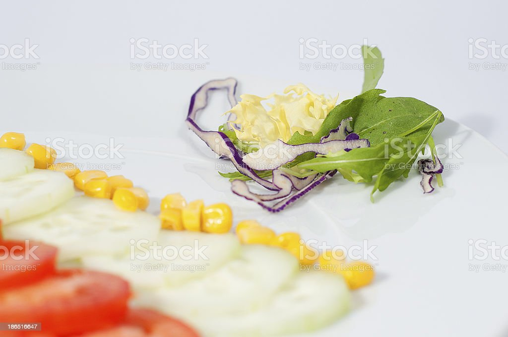 sliced ​​tomatoes, and cucumbers, with corn royalty-free stock photo
