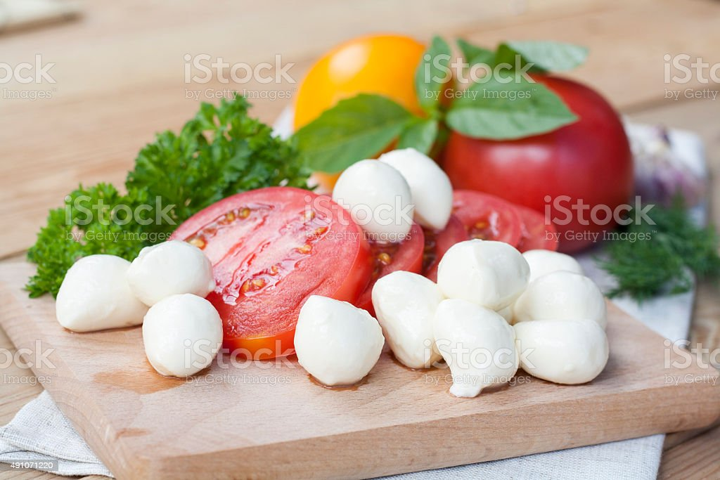 Sliced tomatoes, basil and mozzarella cheese royalty-free stock photo