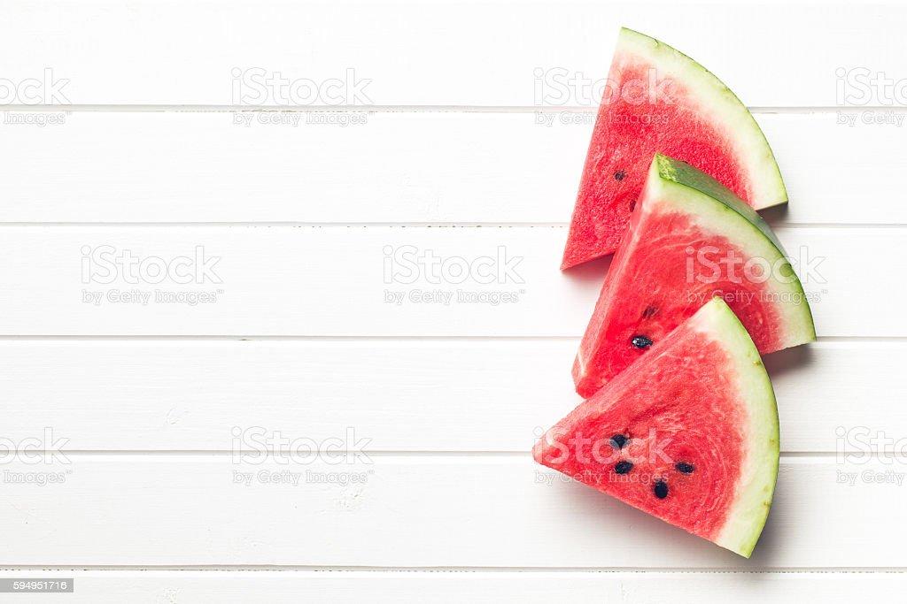 sliced watermelon on kitchen table stock photo