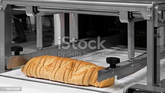 Sliced white bread in a cutting machine
