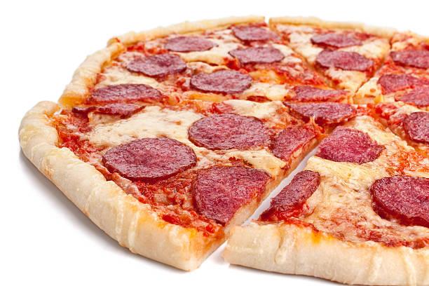 sliced whole salami pizza stock photo