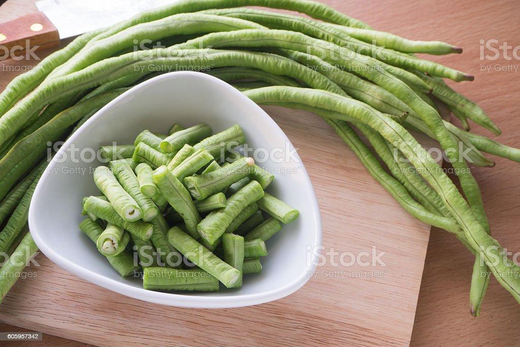 Sliced yard long bean vegetable on wooden block. stock photo