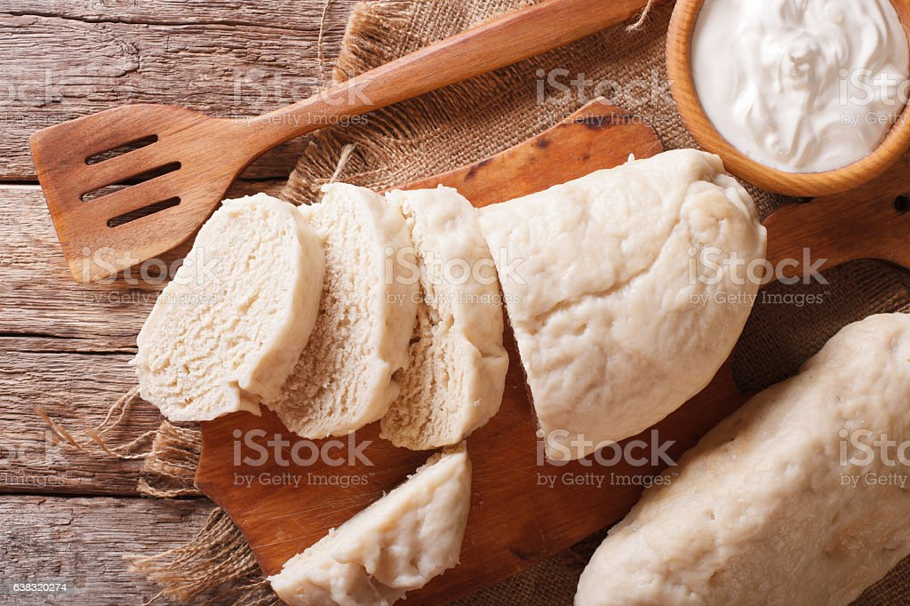 sliced yeast knodel close-up on the table. horizontal top view stock photo