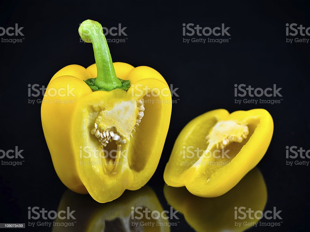 Sliced Yellow Bell Pepper On Black Background royalty-free stock photo