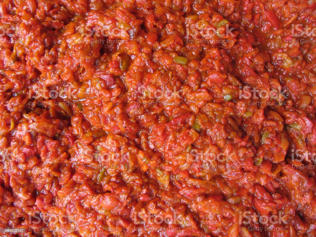 Sliced/mashed and cooked peppers, ajvar stock photo