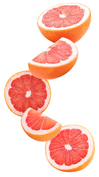 Slices grapefruit flying in the air stock photo