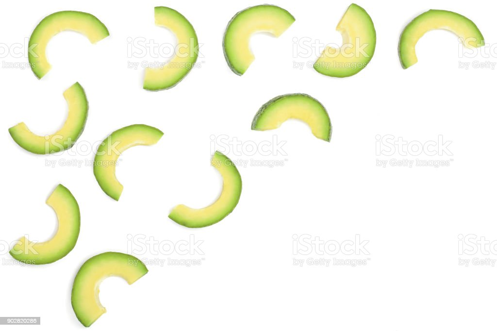slices of avocado isolated on white background with copy space for your text. Top view. Flat lay stock photo