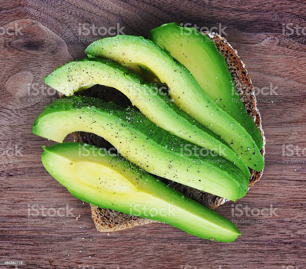 Slices of Avocado on a Bread stock photo