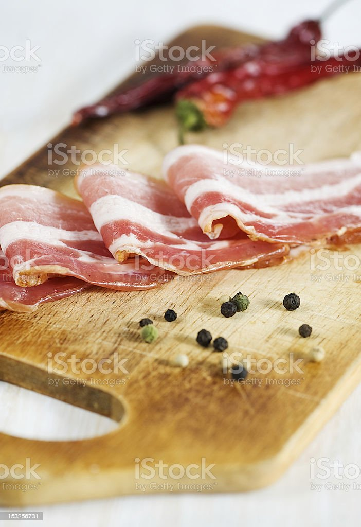 Slices of bacon and pepper royalty-free stock photo