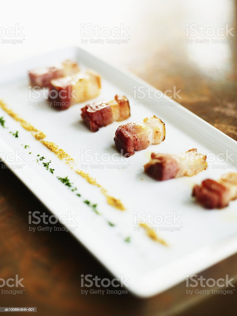 Slices of bacon with powder of sherlin melon, close-up foto royalty-free