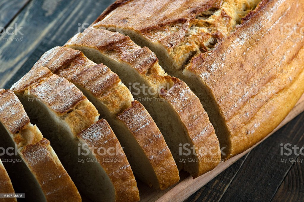 Slices of bread on a cutting board stock photo