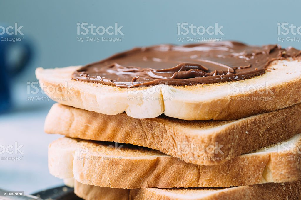 Slices of bread with chocolate cream. Close up. stock photo