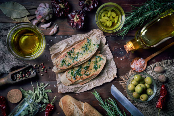 Slices of bread with olive oil and garlic appetizers in a rustic kitchen stock photo
