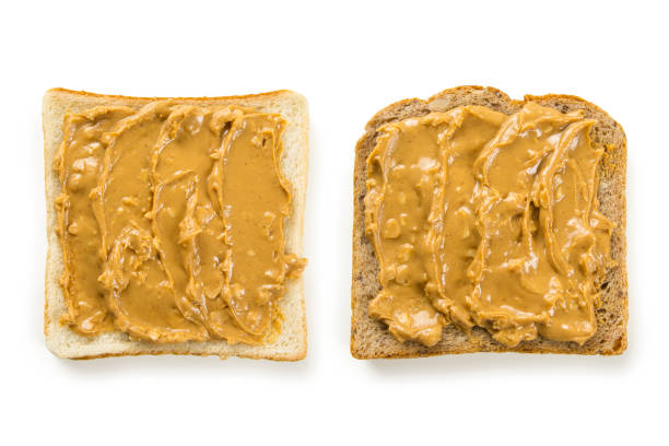 Slices of bread with peanut butter stock photo