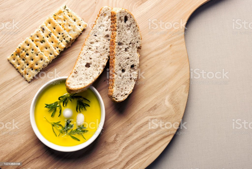 Slices of bread,crackers and olive oil with garlic stock photo