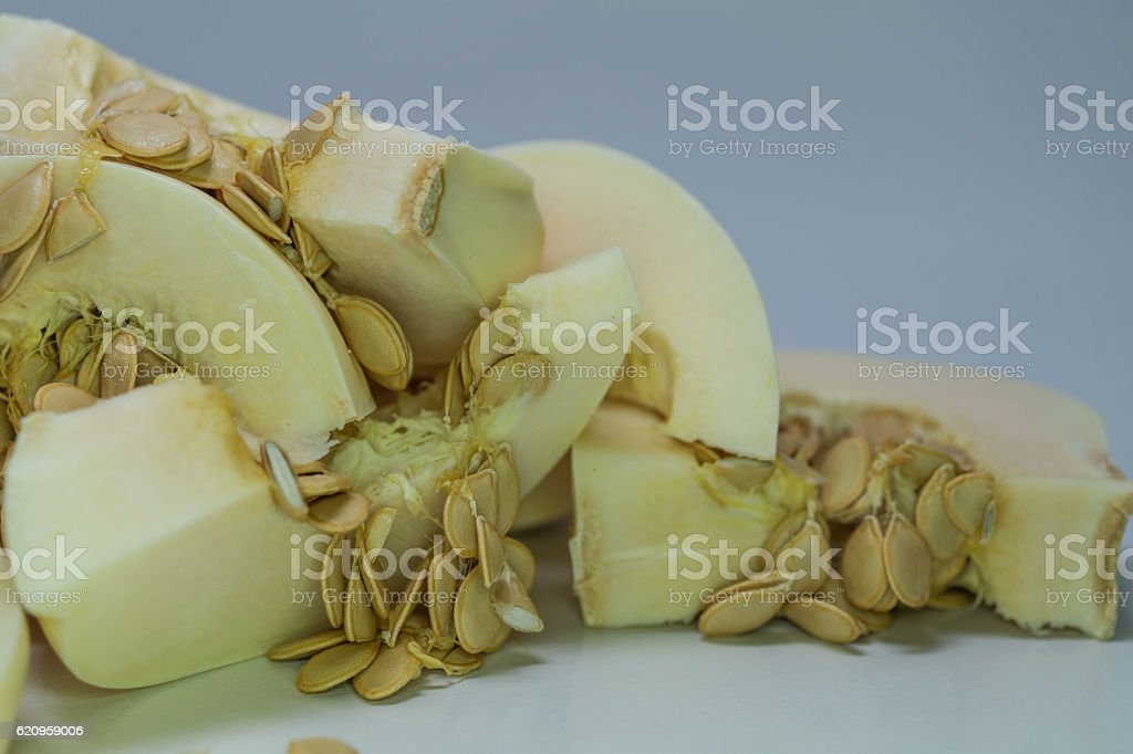 slices of casper pumpkin with seeds in pile royalty-free stock photo