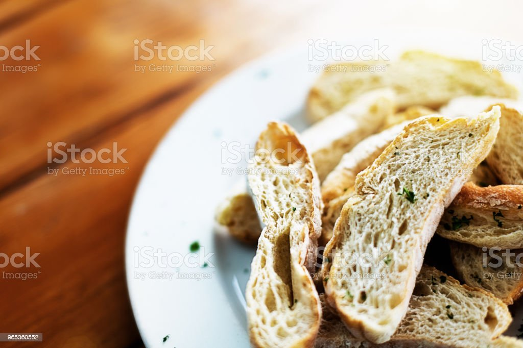 Slices of ciabatta bread on restaurant plate royalty-free stock photo