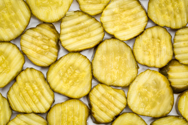 slices of cucumber pickles stock photo