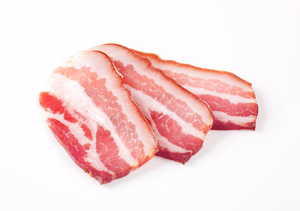 Slices of cured bacon stock photo