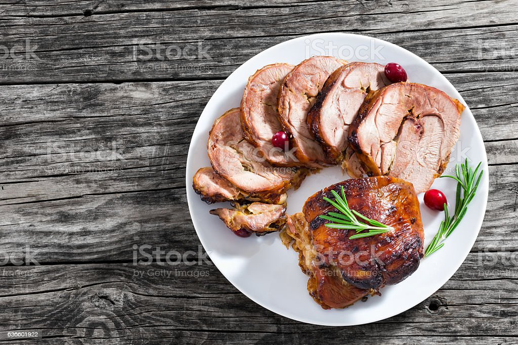 slices of delicious barbecue turkey roulade with cranberry stock photo
