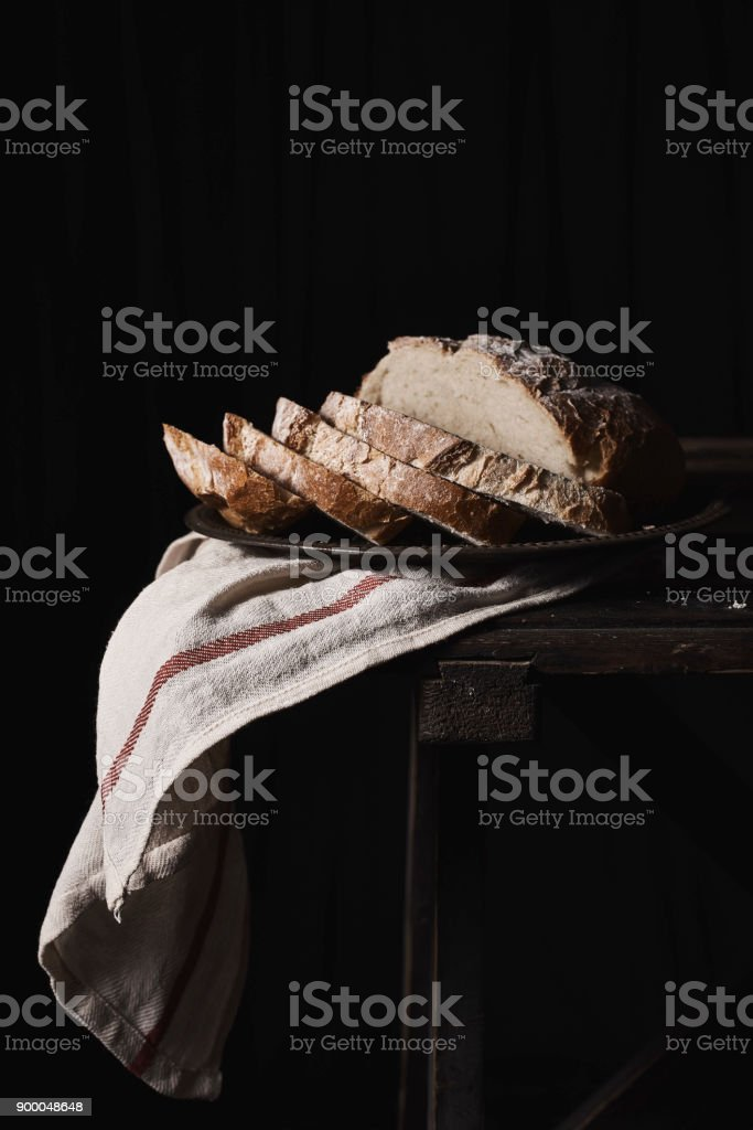 Slices of delicious rye loaf on plate stock photo