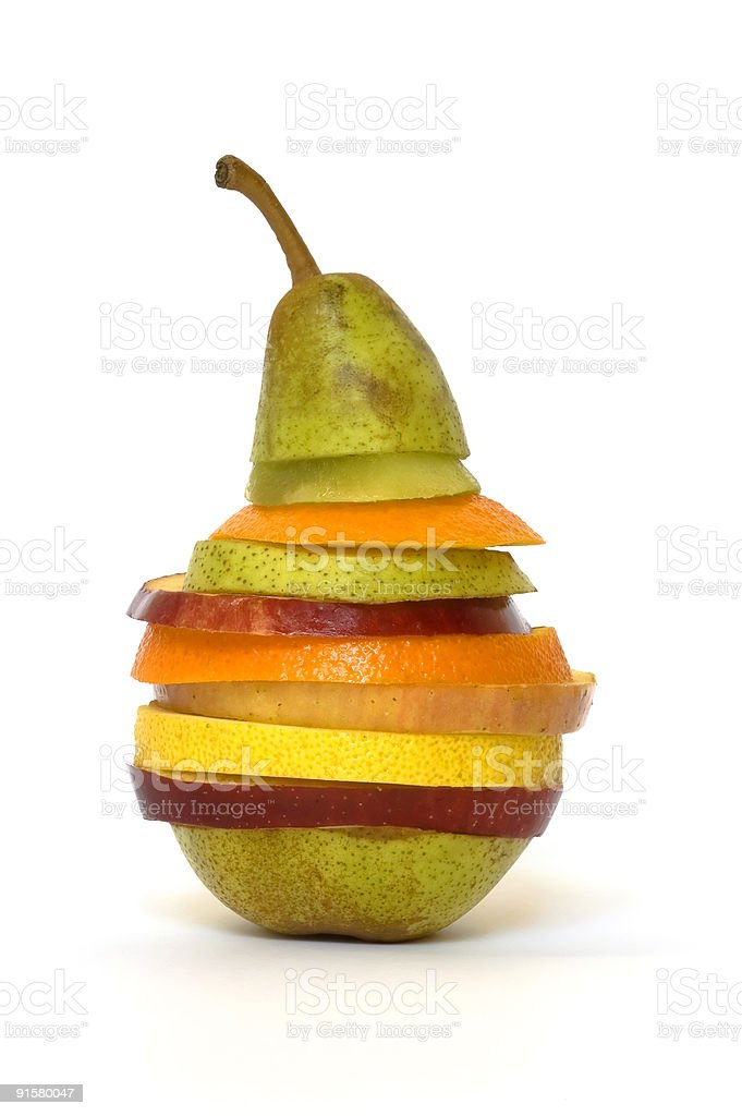 Slices of different fruits, stacked in the shape of a pear royalty-free stock photo