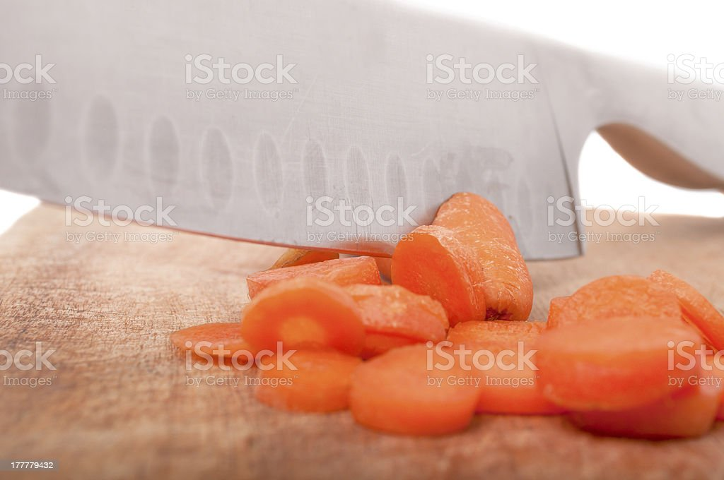 Slices of fresh carrot on a cutting board royalty-free stock photo