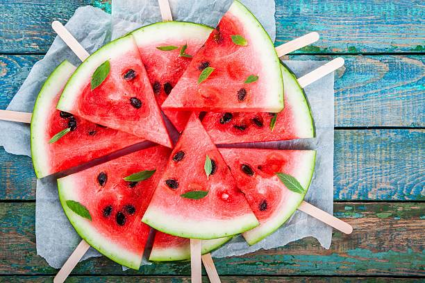 slices of fresh juicy watermelon on a paper closeup - karpuz stok fotoğraflar ve resimler