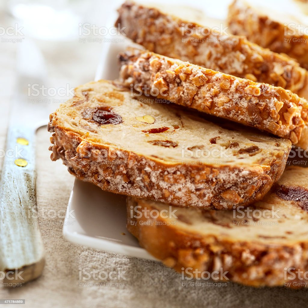Slices of fruit bread on a plate with a knife stock photo