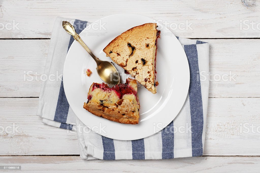 Slices of fruit pie on plate stock photo