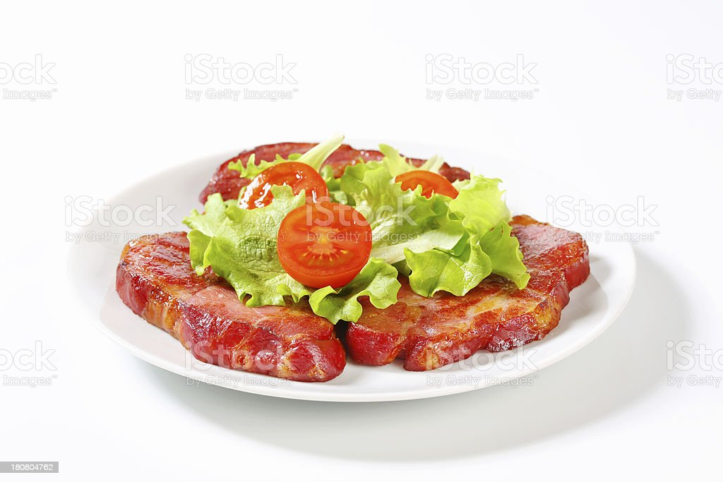 Slices of grilled pork neck with lettuce royalty-free stock photo