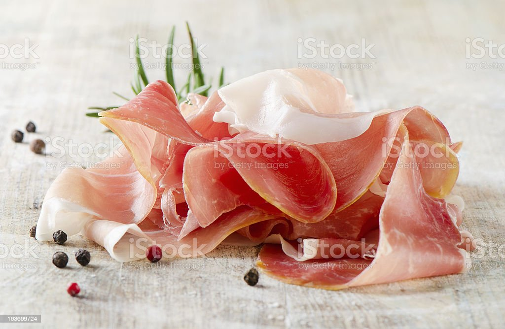 slices of ham and herbs royalty-free stock photo