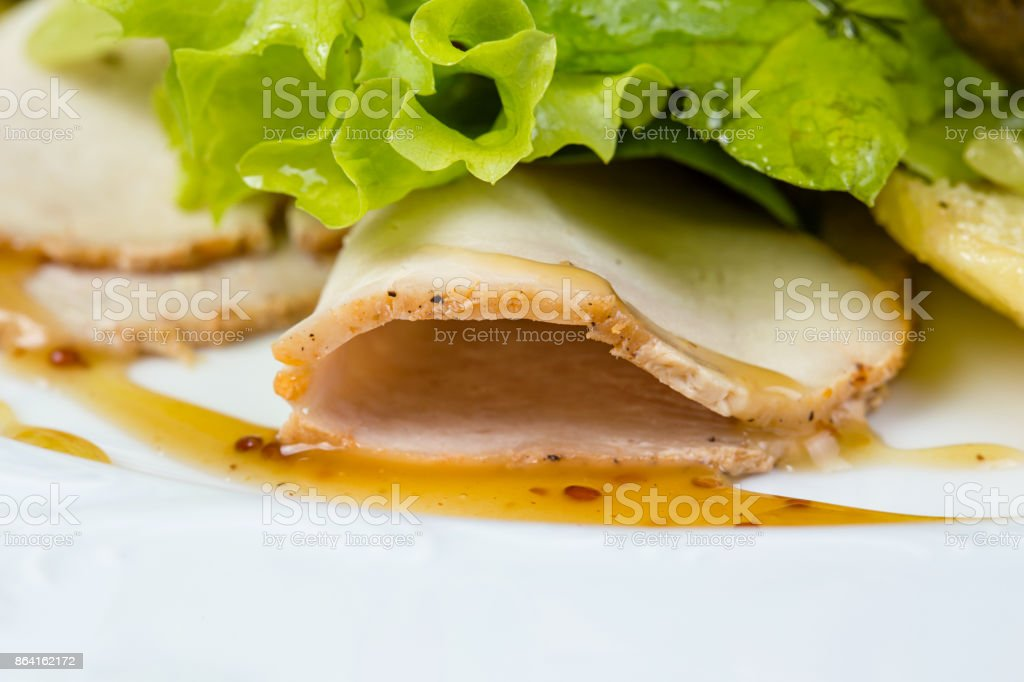 Slices of hamilton and green salad royalty-free stock photo