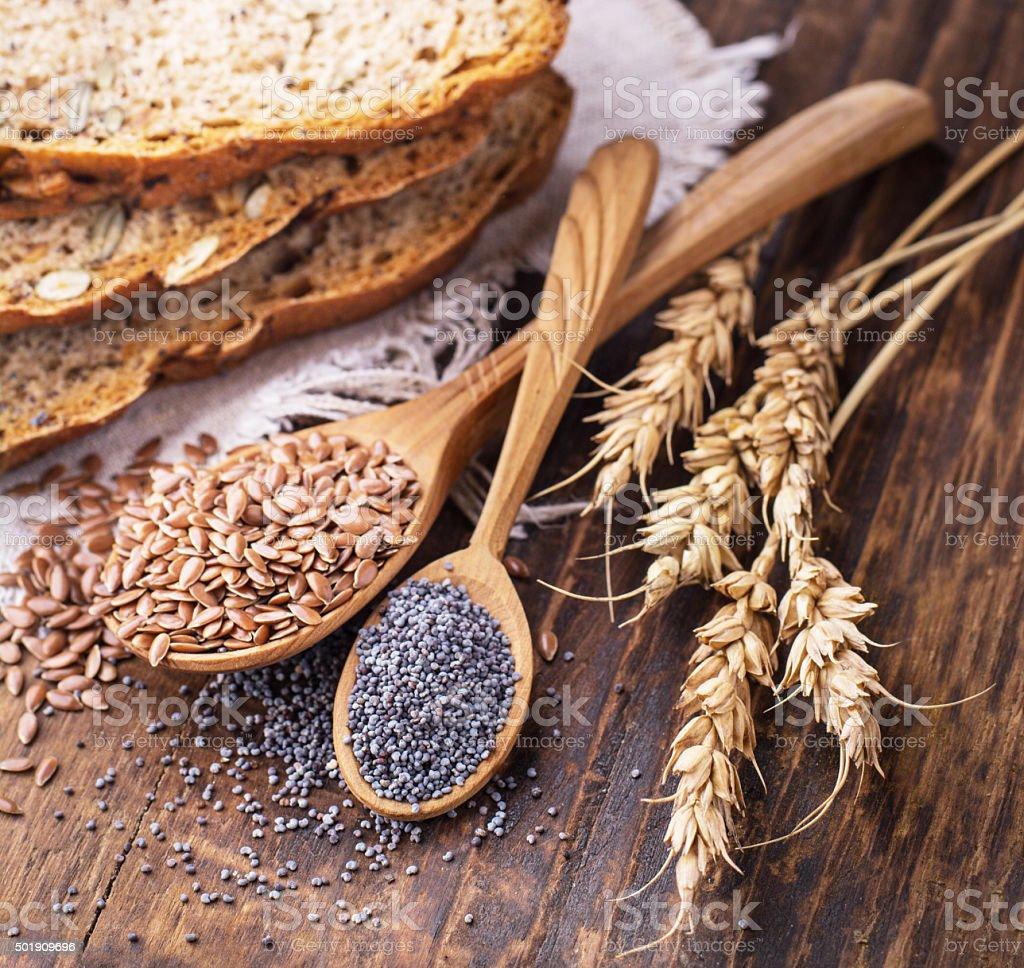 Slices of homemade dark fragrant fresh bread with poppy seeds stock photo