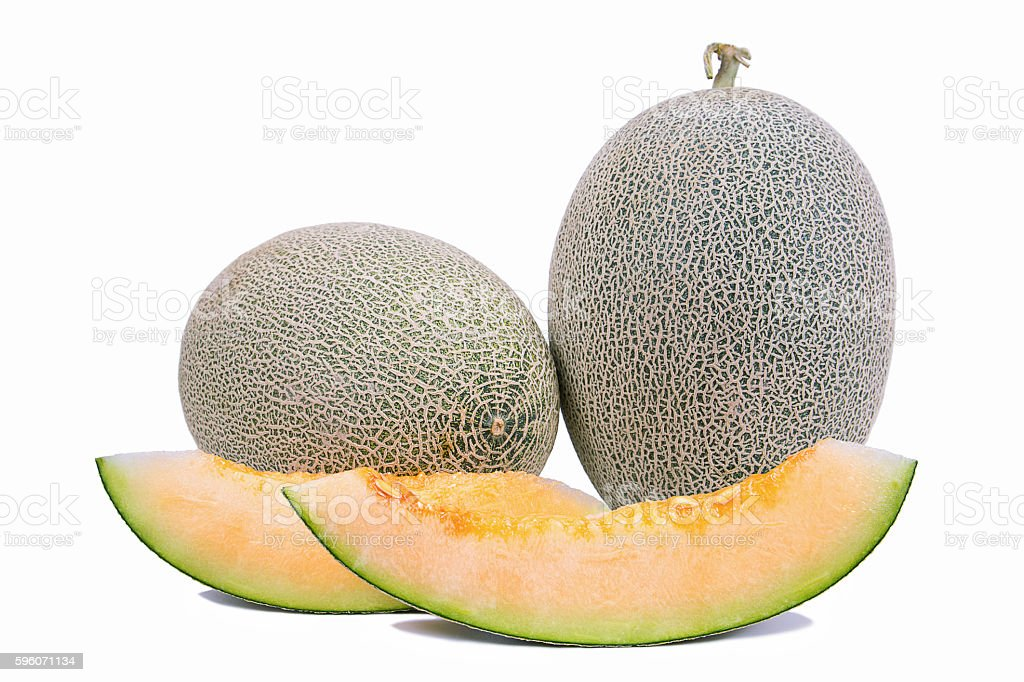 Slices of honeydew melon on white background royalty-free stock photo