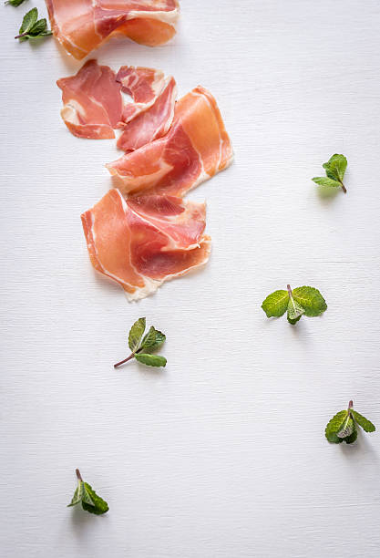 Slices of jamon on the white background stock photo