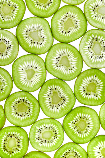 Backlit kiwi slices. Created with Canon 14bit RAW.