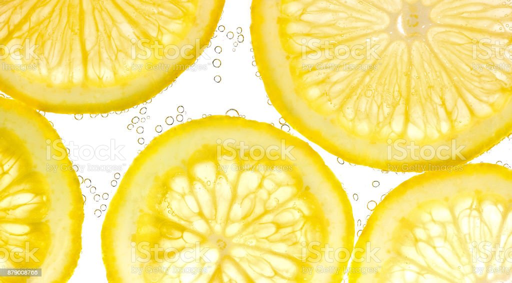 Slices of lemon in water with air bubbles stock photo
