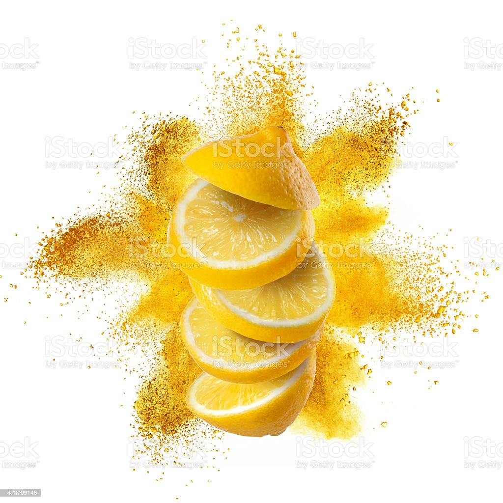 Slices of lemon with yellow powder explosion isolated stock photo