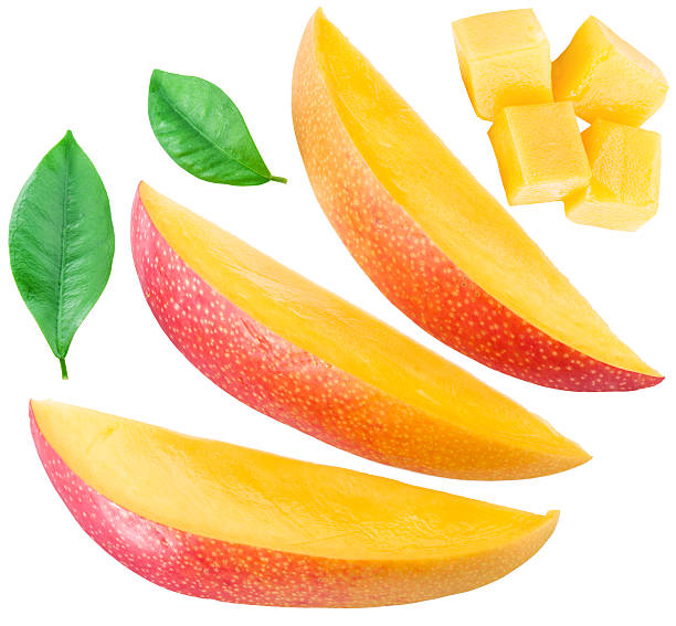 Slices of mango fruit and leaves. Slices of mango fruit and leaves over white. File contains clipping paths. mango stock pictures, royalty-free photos & images