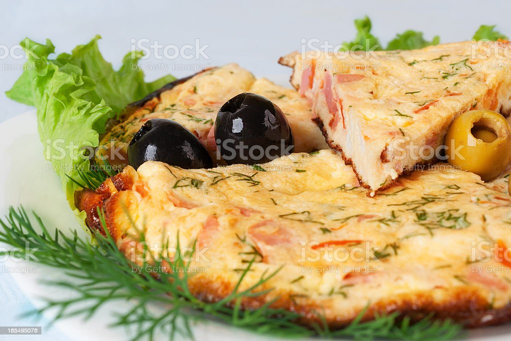 Slices of omelette with olives royalty-free stock photo