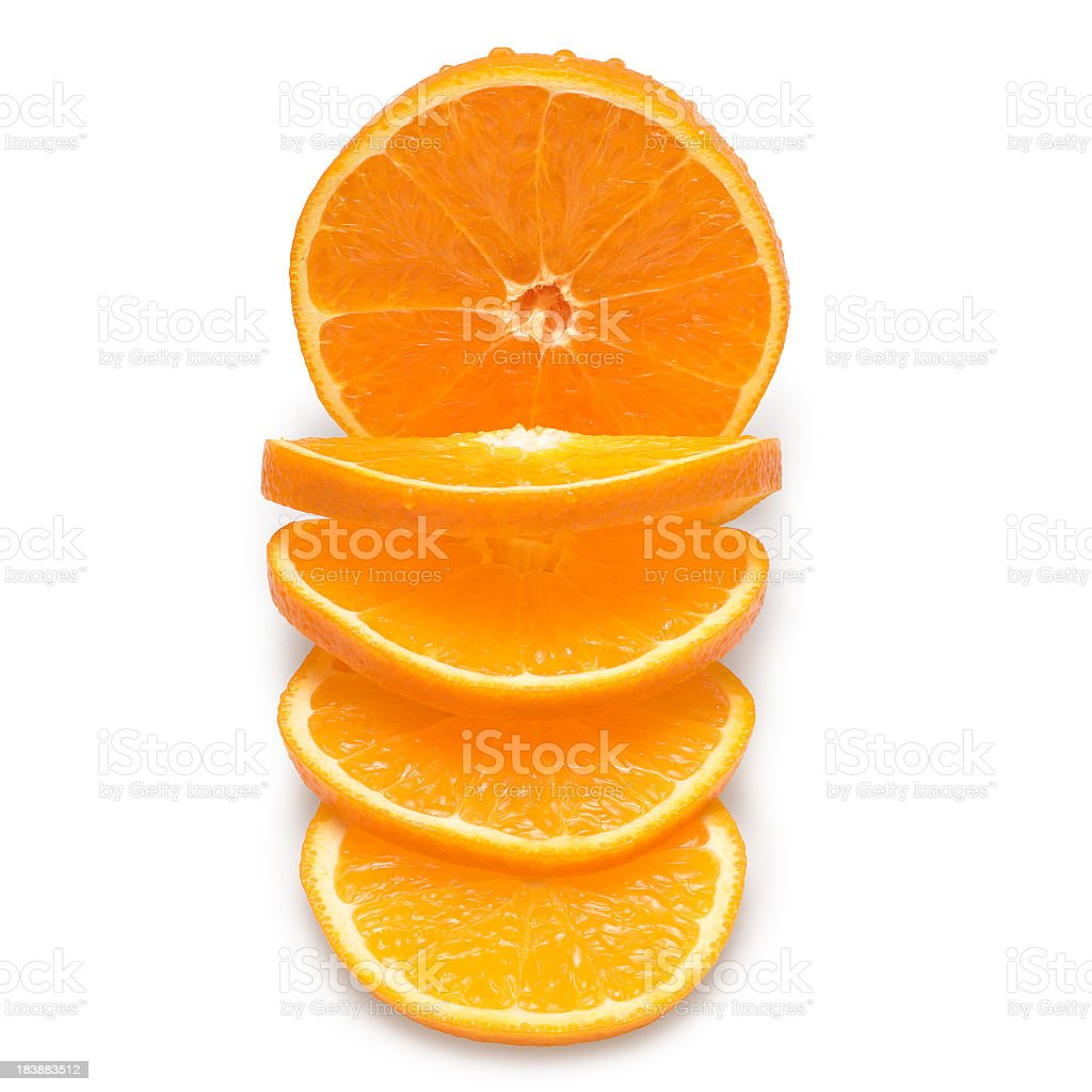 Slices of oranges on a white background royalty-free stock photo