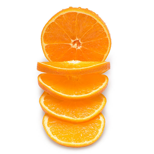 Slices of oranges on a white background stock photo
