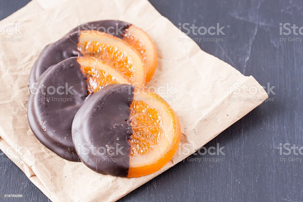 slices of organge coated chocolate stock photo
